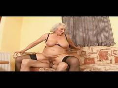 Busty granny gets young cock pounding