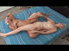 Two granny lesbians licking and toying the pussy !!