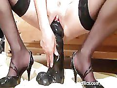 Extreme slut fucks a monster dildo and champagne bottle