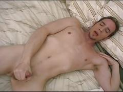 Delicious young twink strips and jerks his sweet cock in solo show