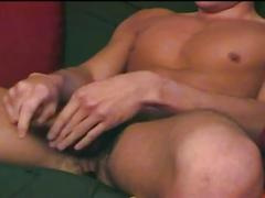 Horny young hunk strips and jerks off