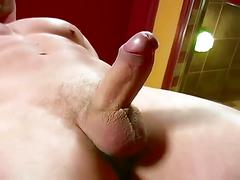 Gorgeous muscled hunk stars in solo stripping and cock jerking