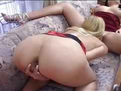Blonde and brunette lesbians licking and sucking pussy