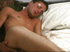 Horny soldier strokes cock and fingers ass