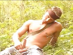 Horny stud jerks hard cock in woods