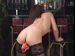 Pretty brunette with perfect ass sends red dildo deep inside her pussy