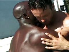 Bodybuilders interracial threesome in pool