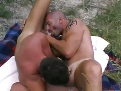 Stemy 69 style throat shoving with muscled studs in the woods
