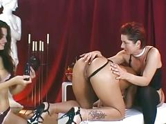 Two brunettes and redhead doing nasty lesbian threesome