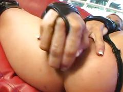 The horny slut masturbating herself on a coach