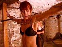 Brunette gets chained up by blonde mistress and spanked