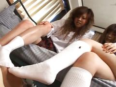 Two japanese school girl tease with a cock