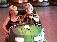 Horny blonde fucked by older guy at amusement park