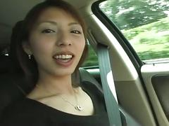 A japanese babe fingering her pussy in a car