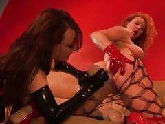 Two hot latex babes get whacked and uses big dildos