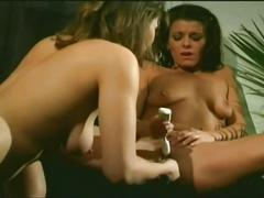 Two classy lesbians eat and toy pussy