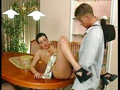 Horny slut fucked on kitchen table!