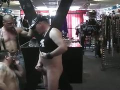 Three horny pig daddies orally pleasing each other in sex shop
