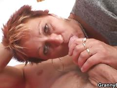 Mature redhead sucks and fucks a horny hunk