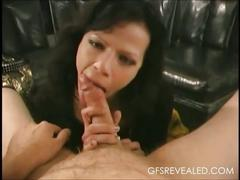 Black haired babe sucking a long cock