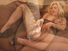 Sexy blonde milf teases with her pantyhose