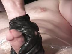 Big cock gay dude wrapped in plastic gets a hot handjob