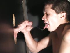 Gay guy sucks a tasty cock through a glory hole