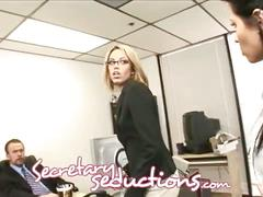 Two sexy chicks share one hard cock in the office