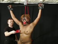 Ebony is strung up and tortured