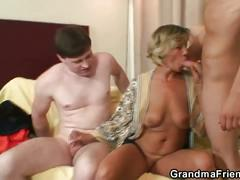 Two young dudes bang busty granny