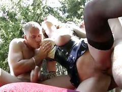 Horny threesome of two dudes fucking a nice babe dressed in leather