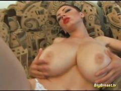 Brunette with huge tits teases and toys her pussy