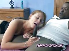 Redhead mariah sucks on a big black cock