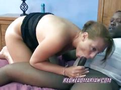 Redhead mariah sucks on a big black cock