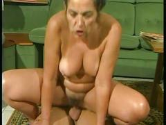 Horny momma fucked by a stiff cock on the floor !!