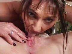Brunette milf and young blonde babe fucking each other's pussy