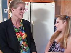 Horny mom and daughter plays in the kitchen