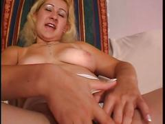 Horny blonde slut plays pussy with her toy