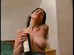 Teen fucking herself with a wine bottle