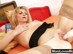 Amateur mom loves pumping big hard dildo