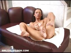 Malezia using a huge dildo and masturbating hard in the sofa