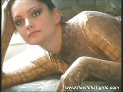 Hot babe dressed in crocodile skin masturbates for the camera