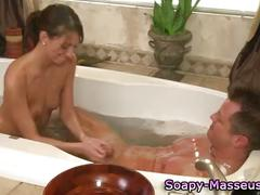 Sexy massage babe and client bathtime blowjob