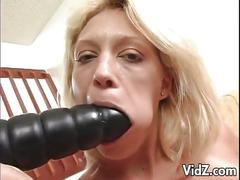 Seductive blonde milf fucks a dildo