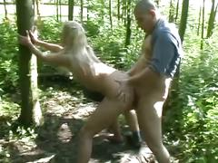 Hot blonde babe fucked by two dudes in the middle of the woods