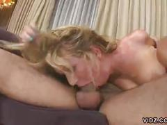 Young blonde babe gags on huge man meat