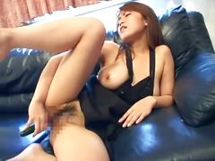 Busty jap pampers own pussy