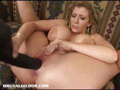 Busty brunette masturbating with a big black dildo