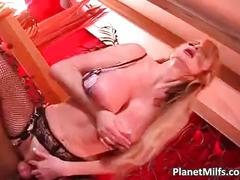 Blonde milf in black stocking satisfying