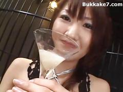 Japanese girl drinks cum from a martini glass